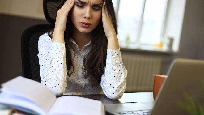 woman stressing over work