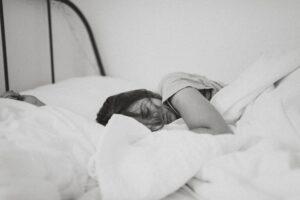 sleeping woman lying on bed