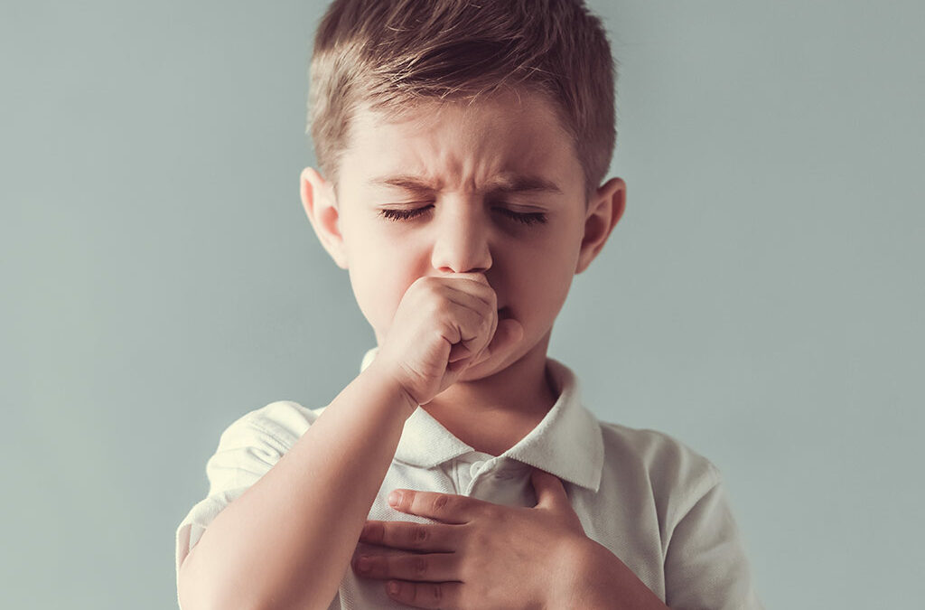 child coughing due to asthma