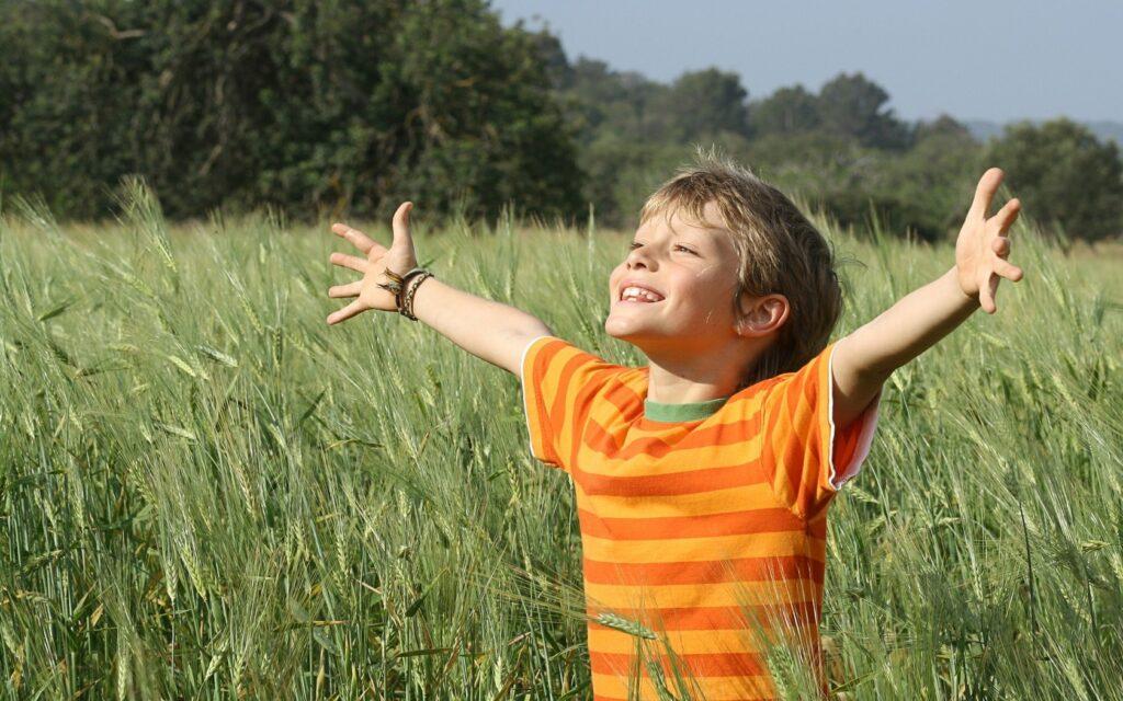 happy kid enjoying in the fields