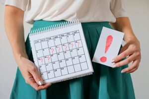 woman holding calendar with marked missed period