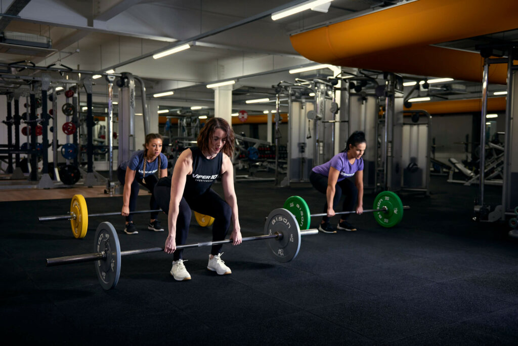 women lifting weight