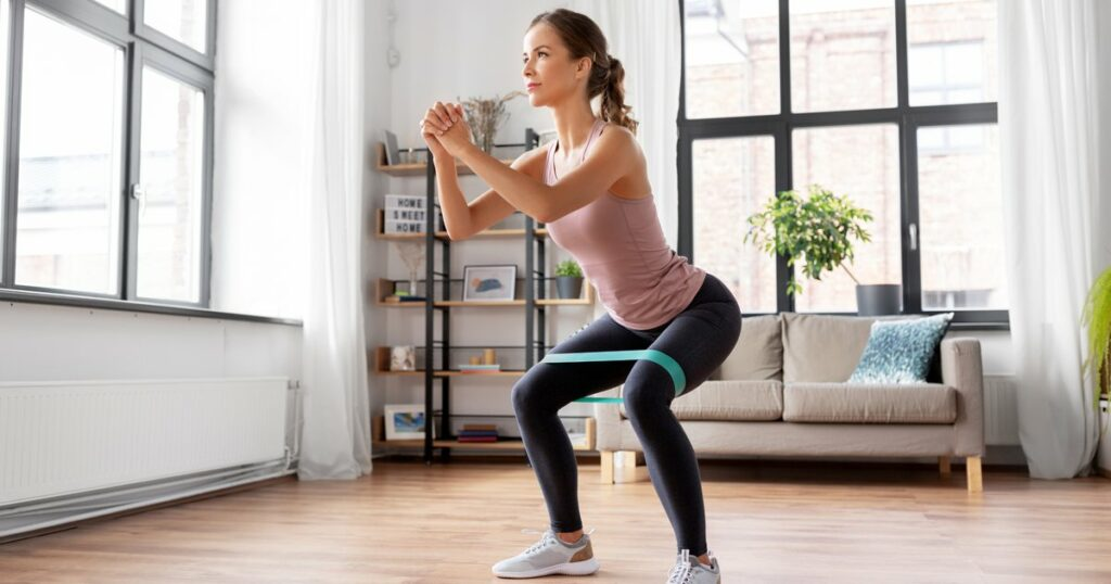 woman doing resistance band exercise